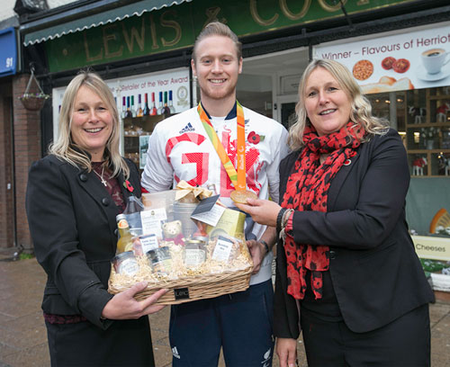 Laurence Whiteley collects a hamper from Victoria Howard & Bettina Bell